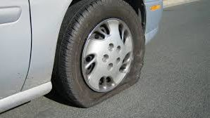 How to drive a short distance with a flat tire?